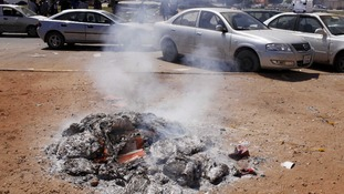 Used ballot booklets set alight in Benghazi, Libya