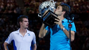 Murray looks away as Federer lifts the 2010 Australian Open trophy, after beating the Scot in the final.