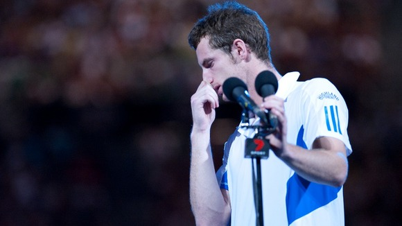 A dejected Murray addresses the crowd following his defeat to Federer in the 2010 Australian Open final.