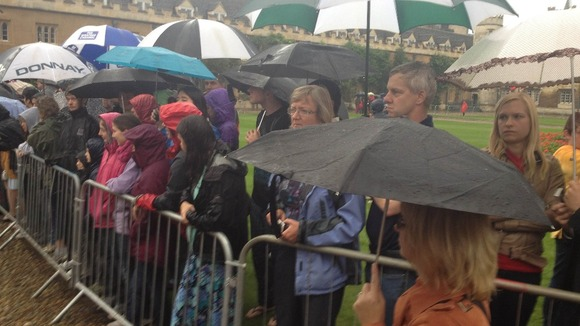 Spectators brave the rain