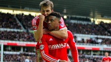 Britt Assombalonga celebrates scoring for Forest at rivals Derby County.