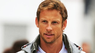 McLaren Mercedes' Jenson Button arrives at the paddock for the British Grand