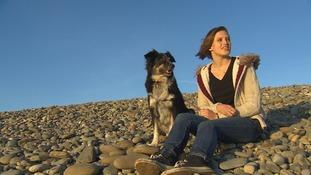 Mair Elliott walking her dog