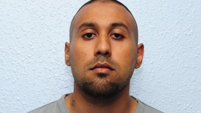 A mugshot of Khawaja released today.