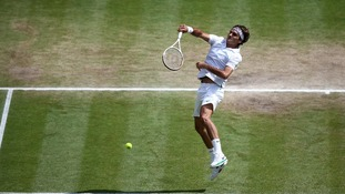 Switzerland's Roger Federer in action against Great Britain's Andy Murray