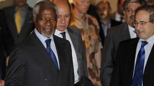 Syria's Deputy Foreign Minister Faisal al-Miqdad welcomes UN-Arab League envoy Kofi Annan at a hotel in Damascus