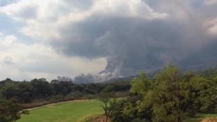Guatemala's Fuego volcano belched black ash.