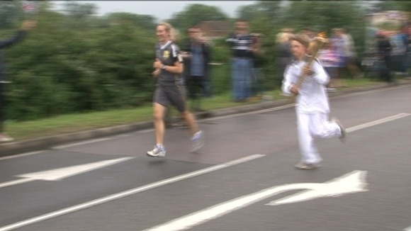 Freddie Wright from Radlett took the torch through Cotton End
