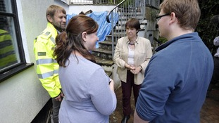 Environment secretary Caroline Spelman (centre) meets Devon residents Philip Nolwenn and Luke Nolwenn