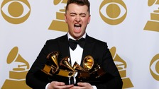 Sam Smith reacts to winning four Grammys.