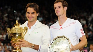 Switzerland's Roger Federer with his winners trophy and Andy Murray with his runners-up trophy