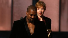 Kanye West leaves Beck on stage at the Grammys last night.