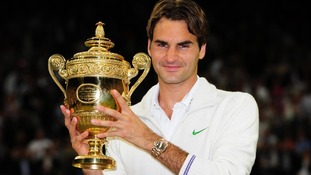 Roger Federer with his winners trophy