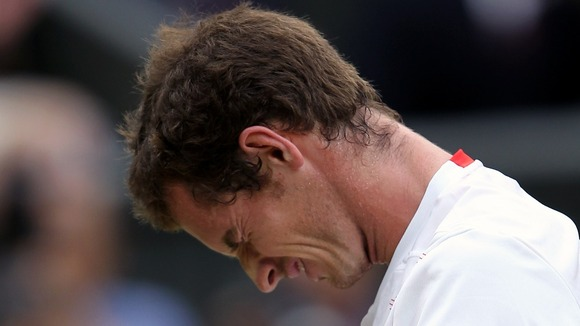 An emotional Andy Murray was beaten by seven-times champion Roger Federer