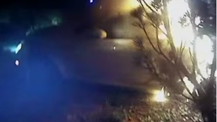 Video of Christmas rescue of man trapped in burning car