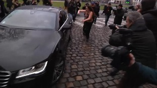 Several women attempted to attack Strauss-Kahn's car when it arrived.