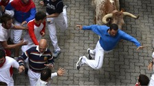 Three men were injured when a bull broke away and charged runners at the Pamplona bull run