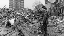 A soldier stands guard over the shattered remains of McGurk's bar in North Queen Street, Belfast in 1971.