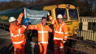 Cabinet secretary Keith Brown (centre) celebrates the completion of the Borders Railway
