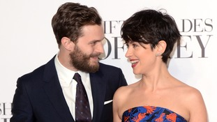 Jamie Dornan (left) and wife, Amelia Warner
