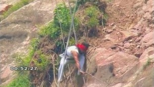 Chinese tightrope walker Aisikaier suffered minor injuries after falling off a high-wire