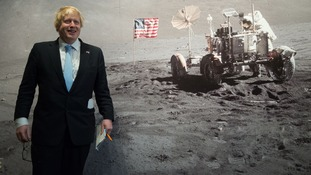 Mayor of London Boris Johnson in front of mural of a lunar landing as he visits the Smithsonian Air and Space Museum in Washington DC.
