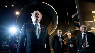 Mayor of London Boris Johnson beside a Saturn 5 rocket as he visits the Smithsonian Air and Space Museum in Washington DC.
