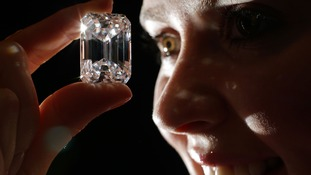 A member of staff examines the diamond at Sotheby's in New Bond Street, London.