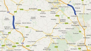 The closed section of the M40 (L) and M1 motorways.