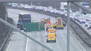 Police at the scene of the collision on the M1 northbound.