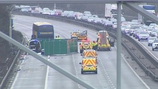Police at the scene of the collision on the M1 northbound