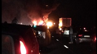 Coach taking families to Disneyland bursts into flames minutes after crash