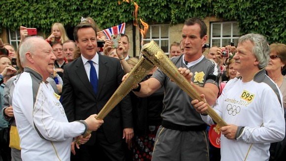 Number 094 Clive Stone MBE (left) is the Prime Minister's nominated Torch Bearer