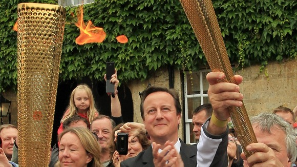 David Cameron seeing the Olympic Torch for himself in Woodstock, West Oxfordshire