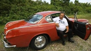 Irvin Gordon sits in his beloved 1966 Volvo coupe