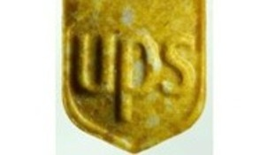 The yellow pills feature the logo of the US parcel service.