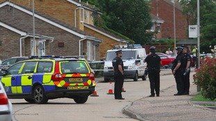 Armed officers at the scene of the shooting
