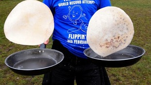 Flipping pancakes at a record attempt