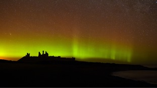 The aurora borealis, or the northern lights as they are commonly known at Dunstanburgh Castle in Northumberland.