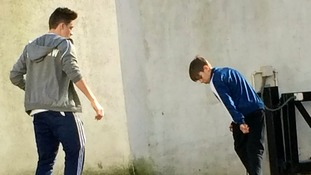 Brooklyn and Romeo Beckham spotted playing football in the street