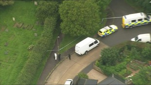 Police officers at the scene in Writtle, Chelmsford.