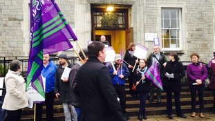 Protesters have gathered outside Kendal's County Hall