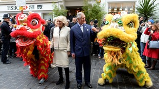 The Prince of Wales and Duchess of Cornwall during an official visit to Chinatown to mark Chinese New Year