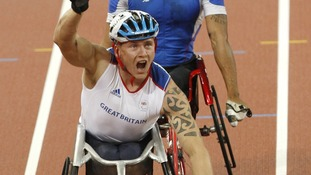 David Weir celebrates after winning gold at the Beijing Olympic Games in 2008.