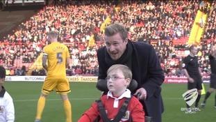 Bristol City Captain Wade Elliott pushes Oskar in front of thousands