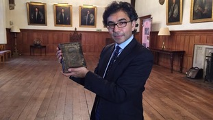 Our reporter Rajiv Popat with the prayer book.
