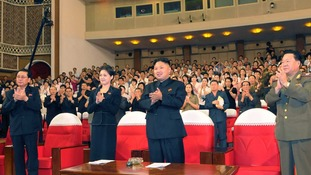 North Korean leader Kim applauds during a demonstration performance by the newly formed Moranbong band in Pyongyang