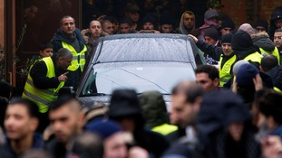 Mourners surround Omar Abdel Hamid El-Hussein's body.