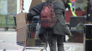 Homeless person with shopping trolley