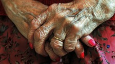 The hands of a resident at a nursing home
